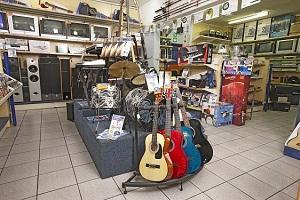 Cash crusader musical instrument store display