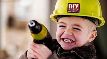 Boy wearing a DIY Depot hardhat with drill