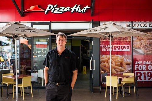 Randall Blackford, general manager for Pizza Hut Africa, poses for a photograph outside the Soweto store. Photographer Waldo SwiegersBloomberg