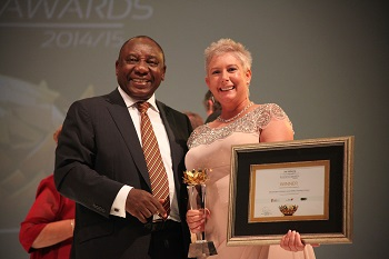 Mr. Ramaphosa handing over the Women-owned Business Award to Marthie at SA PREMIER BUSINESS AWARDS 2014_2015