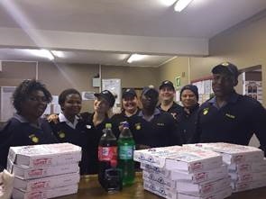 Police officers of Linton Grange Police Station receive Dominos Pizza